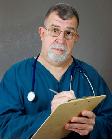 Doctor Listens and Observes Stock Photo