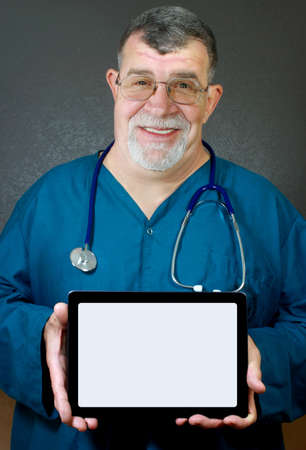 Doctor or Medical Professional Holds a Tablet Computer with a Blank Screen photo