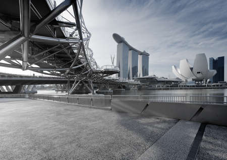 marina bay: Marina Bay, Singapore - December 30, 2011: Located at the Marina Bay Sands in Singapore, the Helix Bridge over the river.