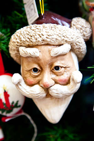 A Santa Clause ornament on a Christmas Tree Imagens