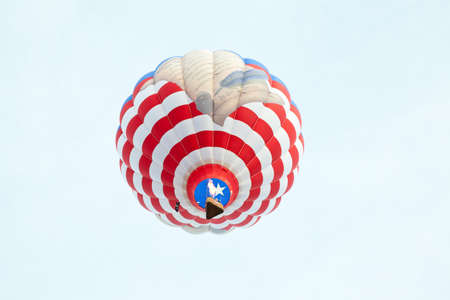 preamble: A hot air balloon with a United States Flag and a scrooll reading the preamble of the United State Constitution. Carolina Balloon Festival, Statesville, North Carolina.