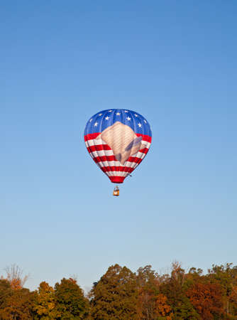 A hot air balloon with a United States Flag and a scrooll reading the preamble of the United State Constitution. Carolina Balloon Festival, Statesville, North Carolina. photo