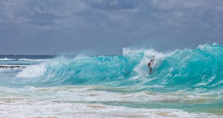 Body Surfers take to the shore break at Oahu s Sandy Beach Park, Hawaii photo