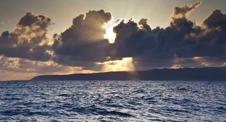 The sun rises over the North Shore as seen from the Pacific Ocean  Oahu, Hawaii photo