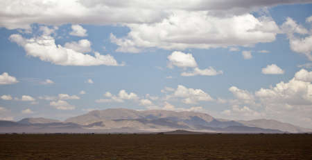 A panorama of the savanna and mountain range in the Serengeti National Park, Tanzania Stock Photo