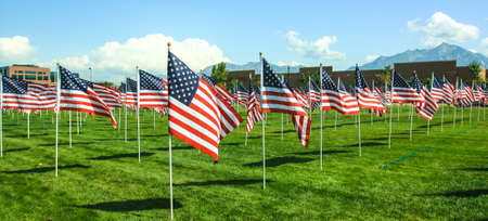 American Flags wave in the wind at a memorial in Utah  Fourth of July, Memorial Day, September 11th, Veteran 版權商用圖片