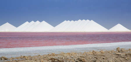The seas salt mining operation on the caribbean island of Bonaire. The chemical reaction in the water turns it bright pink.