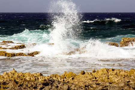 come in: The waves come crashing in on Bonaires windward coast.
