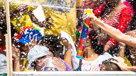 Barranquilla, Colombia - March 1, 2014 - Families and friends battle with white foam in the stands of the Barranquilla Carnival. The foam is basically soap and water sprayed from an arosol can. Editorial