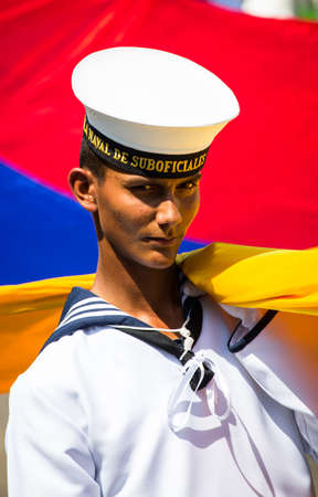 Barranquilla, Colombia - March 1, 2014 - A Colombian naval cadet carries the flag to start the Battala de Flores during Carnival de Barranquilla. Editorial