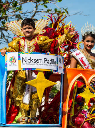Barranquilla, Colombia - March 1, 2014 - Nickson Padilla and Paula Jurado wave to the crowd after being named king and queen of the Carnival de los Ninos 2014. Seen here riding a float in the Battalla de Flores. The pinnacle parade of the Carnival de Barr
