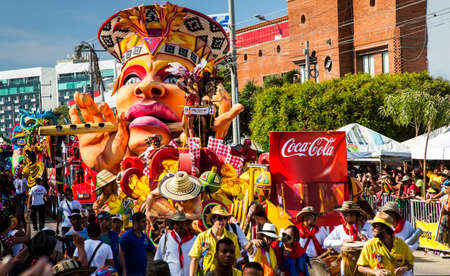 Barranquilla, Colombia - March 1, 2014 - Colorful floats full of singers, dancers, and models make their way down the street during the Battalla de Flores. The pinnacle parade of the Carnival de Barranquilla.