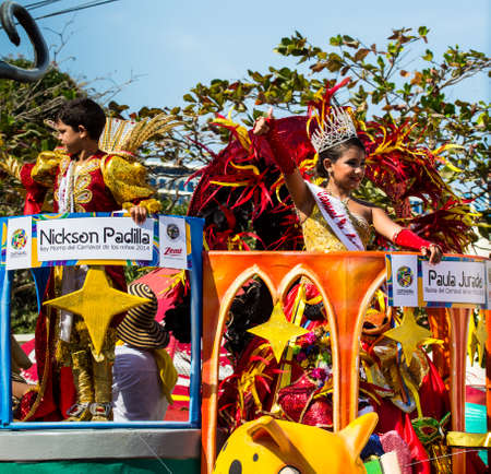 to paula: Barranquilla, Colombia - March 1, 2014 - Nickson Padilla and Paula Jurado wave to the crowd after being named king and queen of the Carnival de los Ninos 2014. Seen here riding a float in the Battalla de Flores. The pinnacle parade of the Carnival de Barr