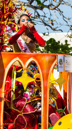 padilla: Barranquilla, Colombia - March 1, 2014 - Nickson Padilla and Paula Jurado wave to the crowd after being named king and queen of the Carnival de los Ninos 2014. Seen here riding a float in the Battalla de Flores. The pinnacle parade of the Carnival de Barr