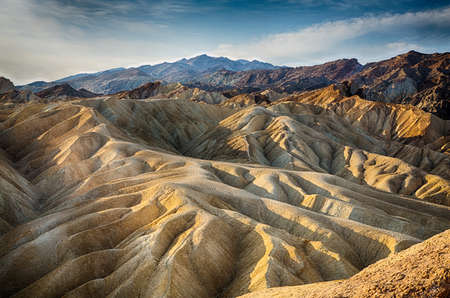 The sun rises over Zabriskie Point in Death Valley National Park, California, USA photo