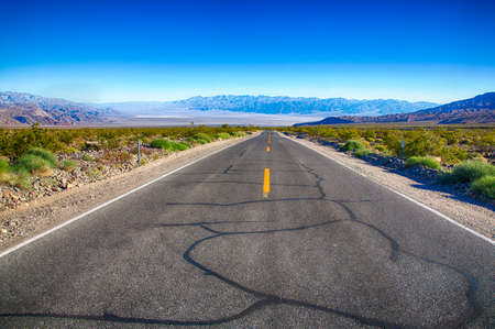 valley below: The road from the west side of Death Valley with a view of the valley floor below. Stock Photo