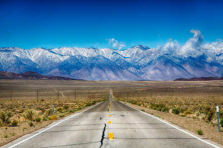 highway road: A road trip along the Eastern Sierra Nevada Mountain Range, California, USA.