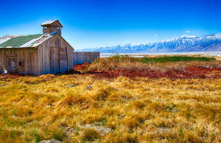 nevada: The fields of an old farm at the foot of the Eastern Sierra Nevada Mountain Range. California, USA