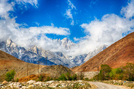 continental united states: The peak of Mount Whitney as it breaks through the clouds. Highest peak in the continental United States. Stock Photo