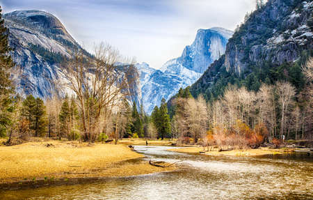 merced: Half Dome and North Dome as seen from the Merced River below. Yosemite National Park, California.