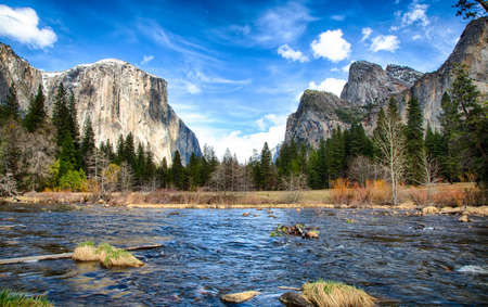merced: El Capitan towers above the valley floor. View from the Merced River, Yosemite National Park, California. USA