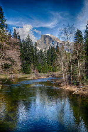 Half Dome towers above the Merced river. Yosemite National Park, California