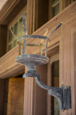 sconce: An old iron sconce in a historic spanish mission house.