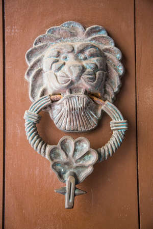 ornate door: Ornate door knockers and detail on th famous doors of Cartagenas historic old city. Stock Photo
