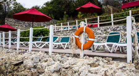 resort life: Life rings stand at the ready along the beach at a Caribbean resort. Stock Photo