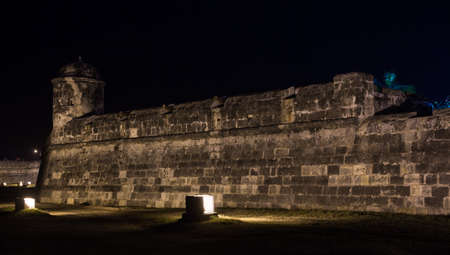 imperialism: The old stone wall surrounding the old city of Cartagena, Colombia at night. Stock Photo