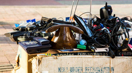 street vendor: Old telephones and other junk on the table of a street vendor in Cartagenas Getsemani neighborhood.