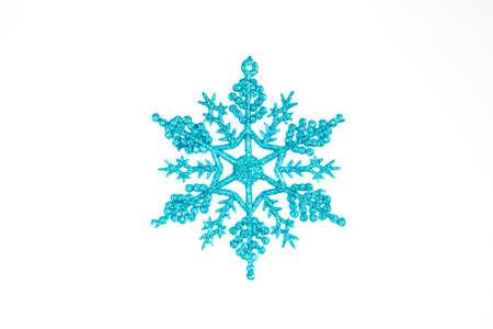 A snowflake Christmas Tree Ornament on a White background. Stock Photo