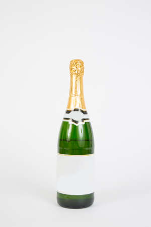 A champagne bottle on a white background. Stock Photo