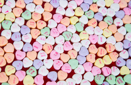 Valentines candy conversation hearts with simple words of love on them.