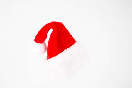 kringle: A red and white santa claus hat on white background Stock Photo