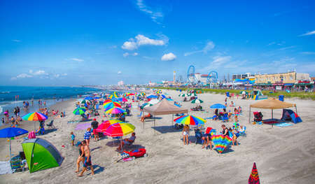 vacationers: Ocean City, NJ - July, 6, 2016 -vacationers enjoy the sun and sand on Ocean Citys boardwalk and beach.