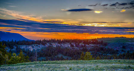 The sun sets over the Pryor Mountain Mustang range near Lovell, Wyoming Stock Photo