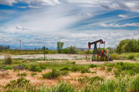 An oil well in the Wyoming plains pulls oil and gas from the ground.