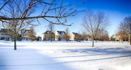 January 24, 2016 Medford, New Jersey: A fresh snowfall covers the commonarea in the colonial subdivision of Village Pointe. Editorial