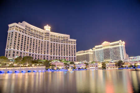 September 13, 2016 Las Vegas, Nevada: The Bellagio resort and casino at night across the lagoon and fountains. Editorial