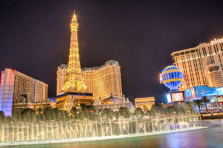 nevada: September 13, 2016, Las Vegas Nevada: The Paris Hotel and casino as seen from the Bellagio fountain after dark. Editorial