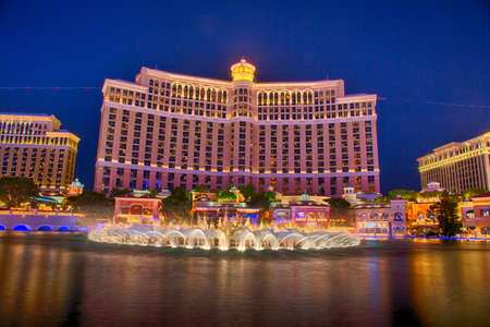 nevada: September 13, 2016 Las Vegas, Nevada: The Bellagio resort and casino at night across the lagoon and fountains. Editorial