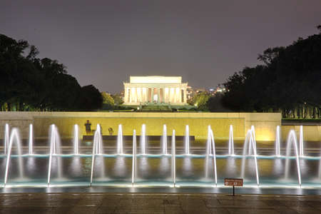 lincoln memorial: The lincoln memorial is visible behind the fountains of the World War Two memorial in Washinton, DC. Editorial