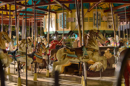 The Carousel on the national mall looks spooky after dark with still animals. Stock Photo