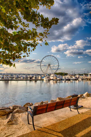 September 10, 2017, Oxen Hill, Maryland, USA: Boats dcked on the national waterfront sit in front of the pier and ferris wheeel in late summer. Editorial