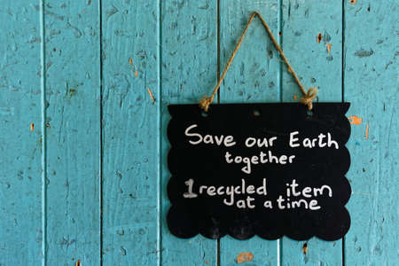 Save our earth sign encouraging us to recycle to save the planet Stock Photo