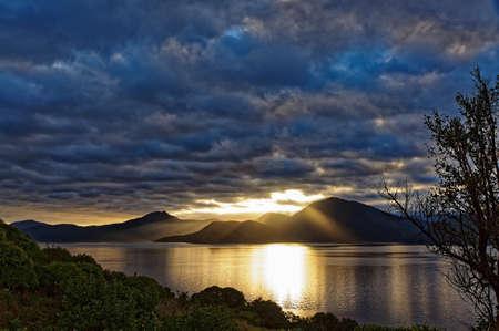 Sunrise over the Marlborough Sounds viewed from Maud Island, New Zealand