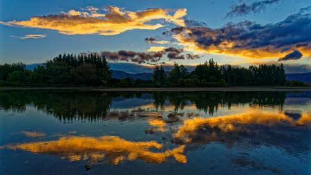 Sunset at the Kumeras with mirror reflection in the high tide, Motueka, New Zealand