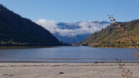 Mokihinui River mouth looking back up the river towards Kahurangi National Park, New Zealand. 写真素材
