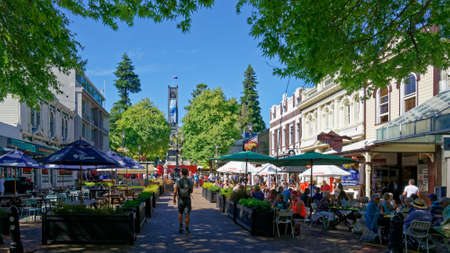 Nelson, Nelson/New Zealand - February 2, 2019: Open air cafes on Trafalgar Street Nelson with Anglican Cathedral in the background, New Zealand.